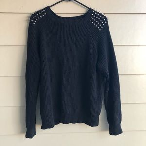 Studded sleeve cable sweater
